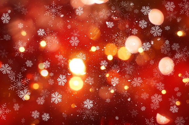 雪とbokehのライトとクリスマスの背景