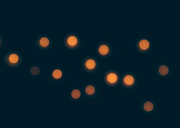 黒の背景にbokehのライト