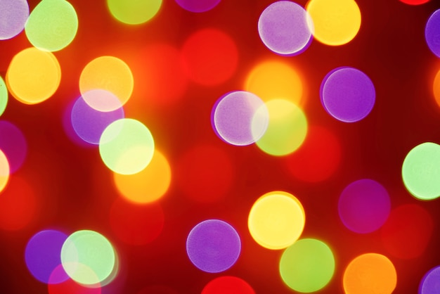 カラフルな休日のbokehぼかし光。抽象的なクリスマスまたは新年の背景。