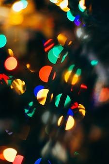 クリスマスの背景、明るいbokeh。背景のぼかし。