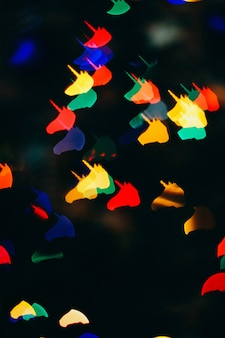 クリスマスの背景、ユニコーンの形のbokeh。背景のぼかし