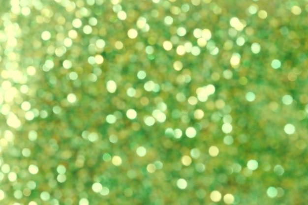 クリスマス抽象的な金と緑のbokehの背景。