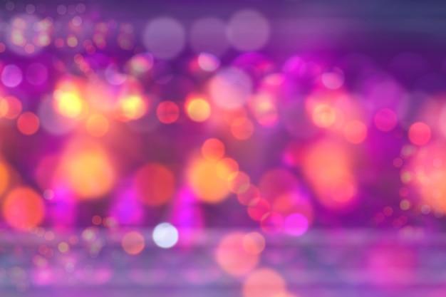 明るい魔法の祝祭の背景のbokeh、休日の夜の光