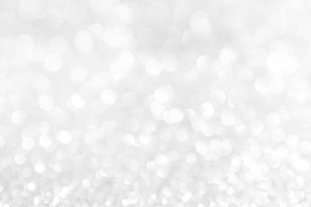 抽象的な背景の白クリスマスbokehのシルバーライト