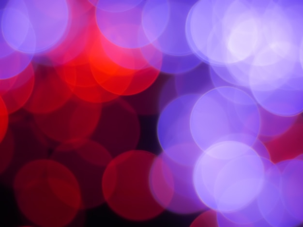 赤と紫の泡の光の色とbokeh抽象的な背景