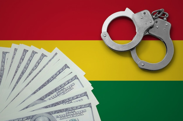 Bolivia flag  with handcuffs and a bundle of dollars. the concept of illegal banking operations in us currency
