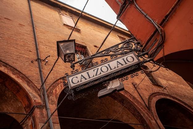 Bologna, italy 17 june 2020: calzolaio sign, in english shoemaker