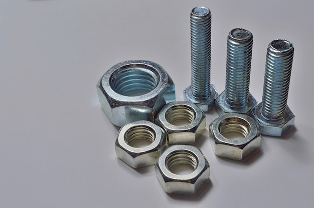 Bolts and nuts of different sizes are laid out