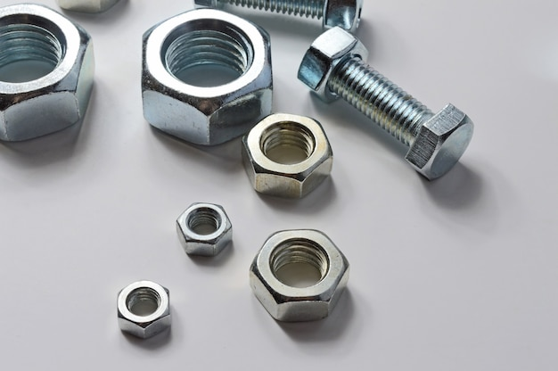 Bolts and screw-nut of different sizes. concept. white background.