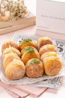 A bombolone or bomboloni is an italian filled doughnut and is eaten as a snack food and dessert