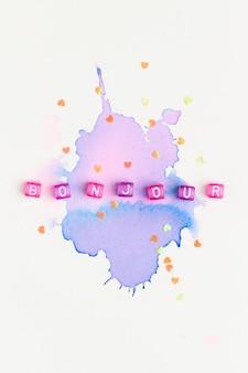 Bonjour perline tipografia di testo su viola