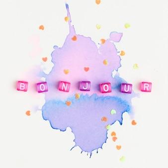 紫の水彩画のbonjourビーズの単語のタイポグラフィ