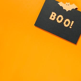 Boo! iscrizione e bat su pezzo di carta nera