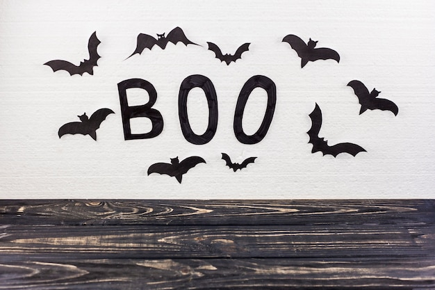 Boo word and black bats on wall