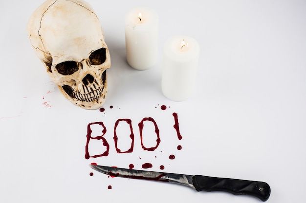 Boo word and skull with candles