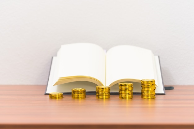 Book and coin pile ideas business growth on the desk