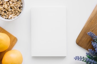 Book cover mockup with oranges and flowers