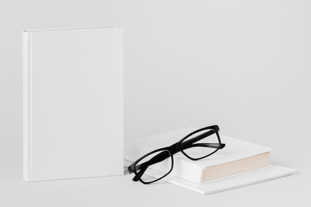 Book and glasses on desk