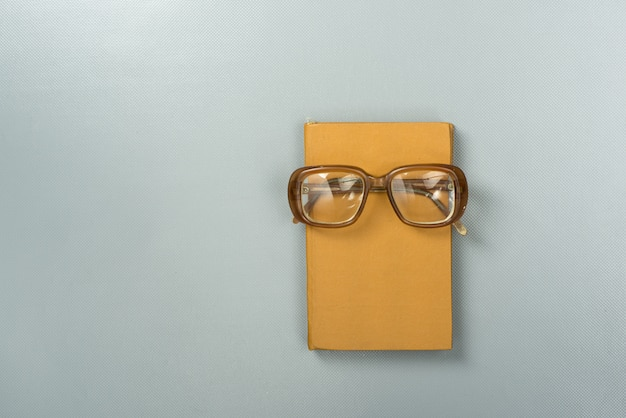 Book and glasses - top view