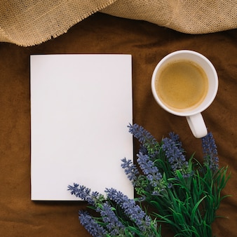 Book mockup with coffee and flowers