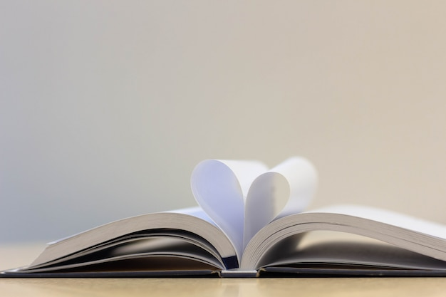 Book page in heart shape , love reading book