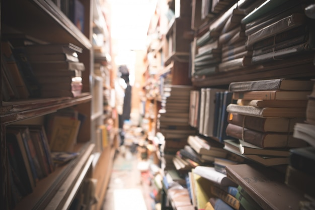 Book shelves with stacks of books
