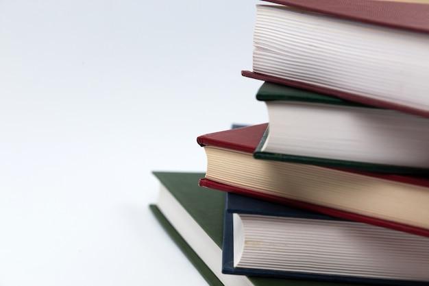 Стопка книг на белом