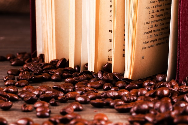 Book stands on coffee beans