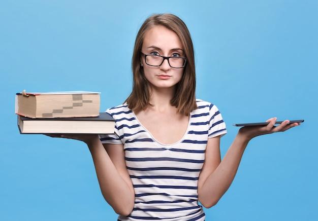 Book vs young woman with e-book. contemporary education concept.