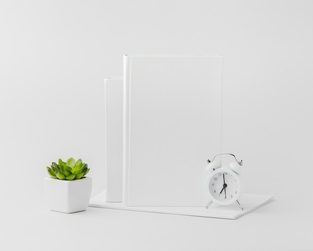 Book with clock on desk