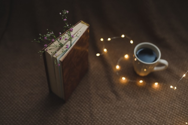 A book with flowers and cup of coffee