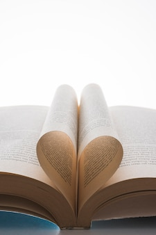 Book with its pages shaping as a heart