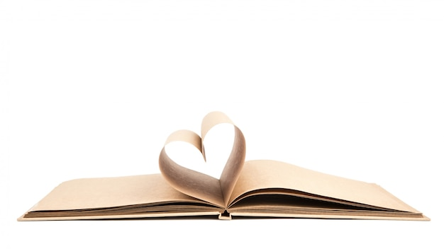 Book with opened pages of shape of heart isolated on white backg