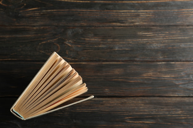 Book on wooden background, top view. self-development