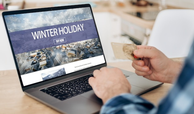 Booking online hotels or winter holidays concept