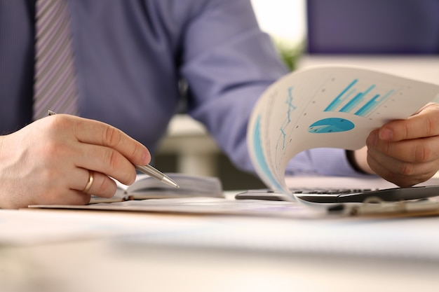 Bookkeeper routine paperwork audit report concept