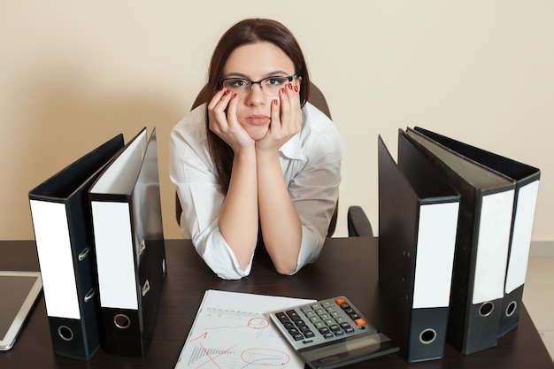 Bookkeeper sitting between documents folders