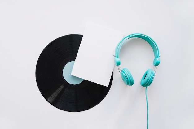 Booklet mockup with vinyl and turquoise headphones