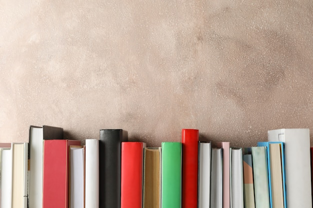 Books against brown background, space for text