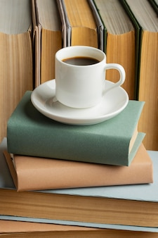 Books arrangement with cup of cofee