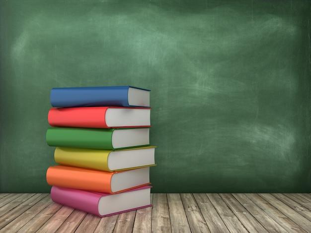 Books on chalkboard background