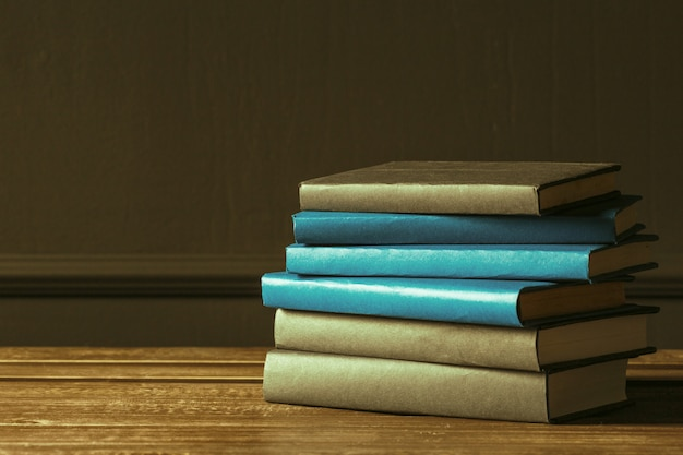 Books close up on old wooden table