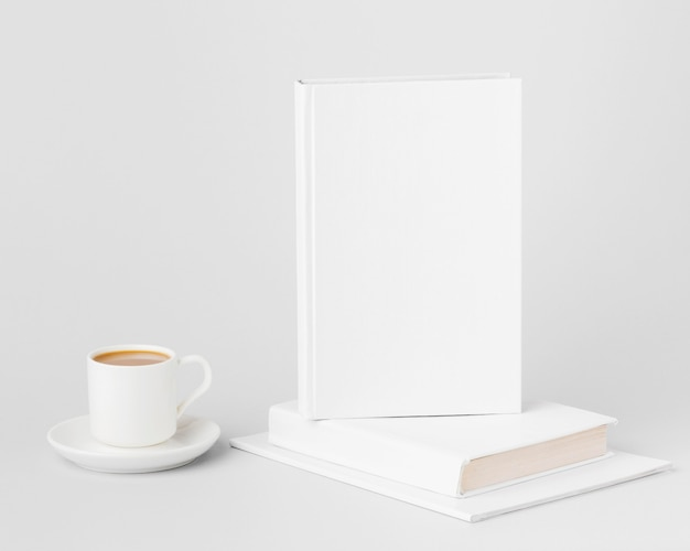 Books on desk with coffee