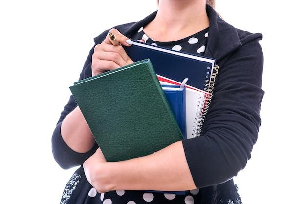 Книги в женских руках крупным планом, изолированные на белом