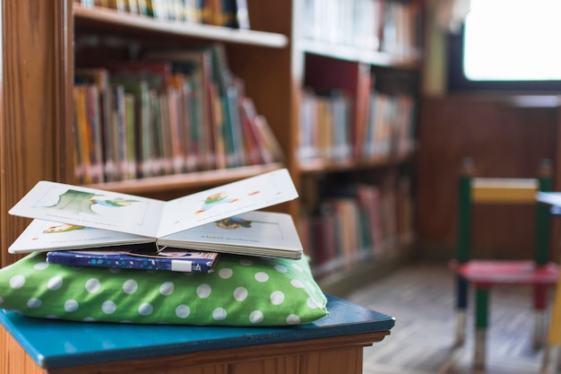 Books lying on pillow in library