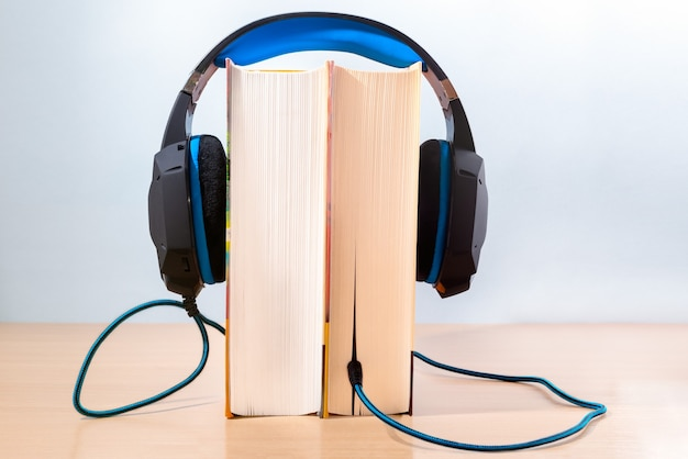 Books and modern headphones