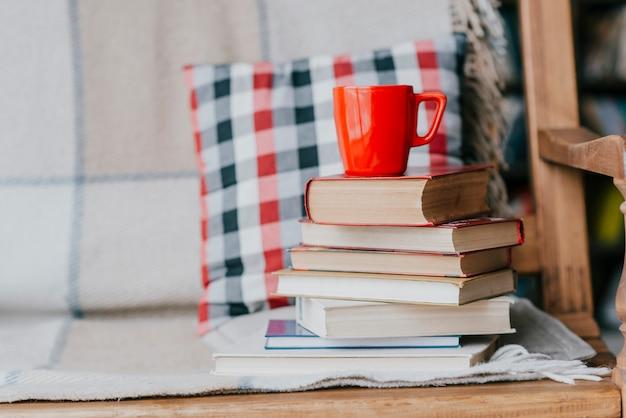 Books and mug on sofa