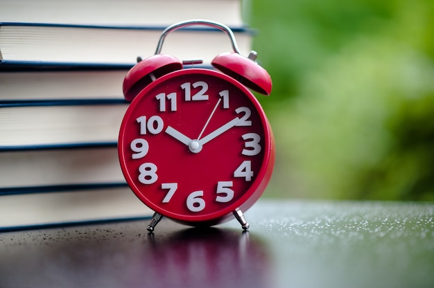 Books and red clocks. put on the floor. white leather book and study the concept of empath
