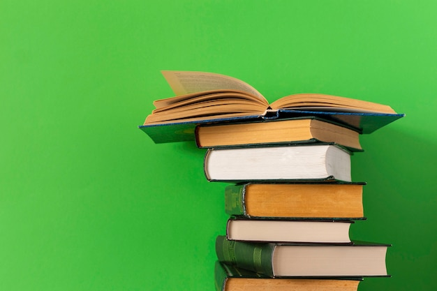 Books stack on a green background