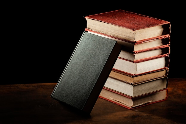Books stack on wooden table